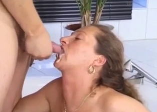 Mommy takes her son's big load