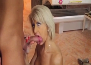 Short-haired MILF takes a facial from her son