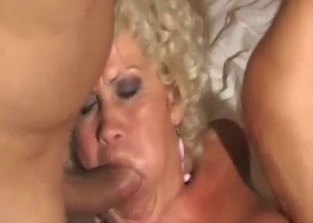 Tanned and curly blonde fucks her sons