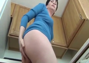 Thick mommy gives her son a few upskirt glimpses