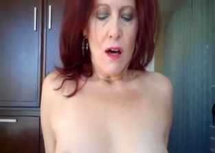 Redheaded MILF rides her son's massive cock